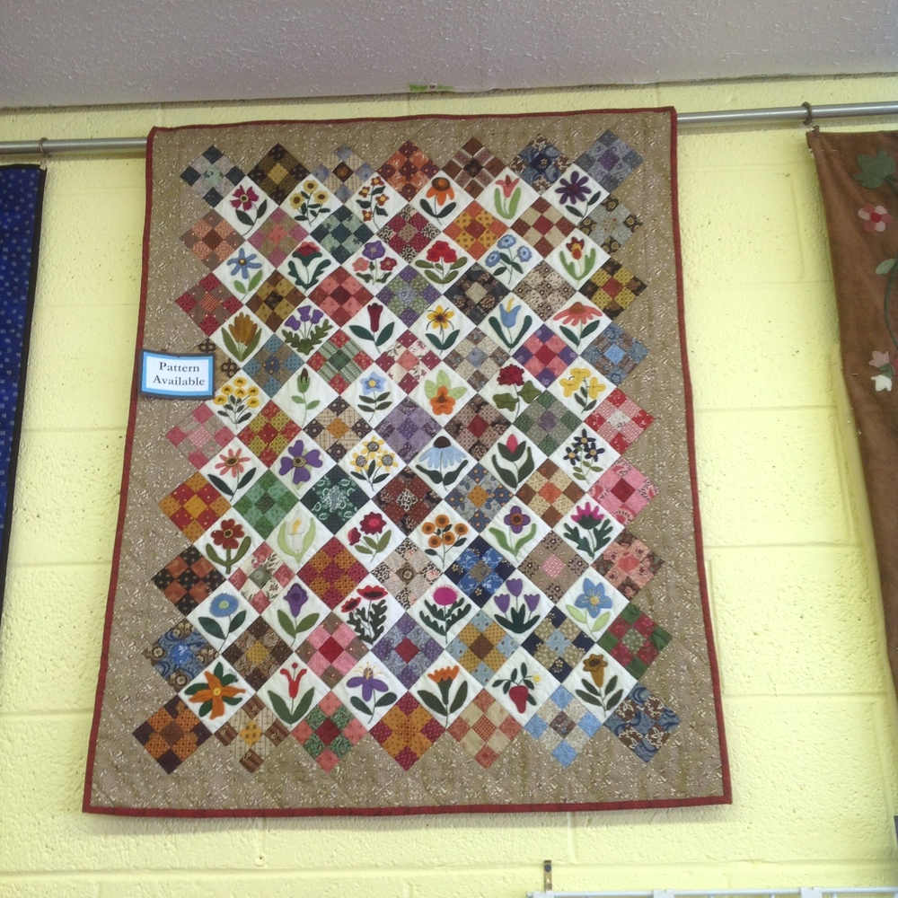 The unique quilt made of wool applique and pieced blocks.