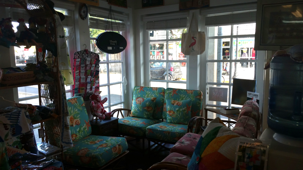 Sitting/waiting area in the front of the shop.  (Also displays upholstered chairs.)
