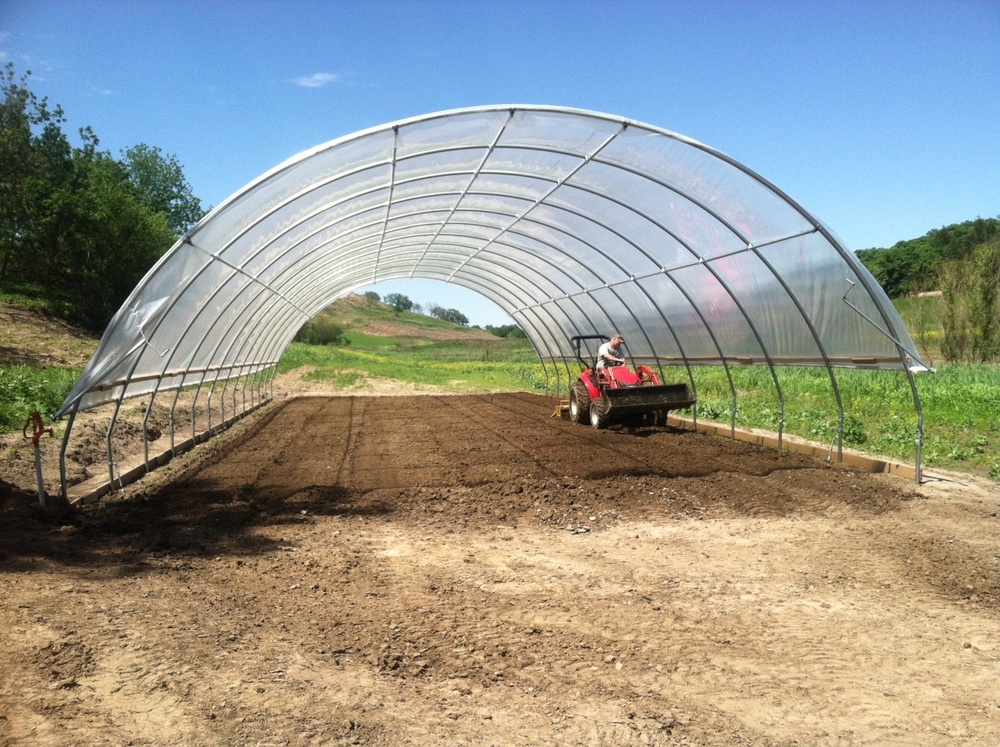 Tilling the Hoop House.JPG