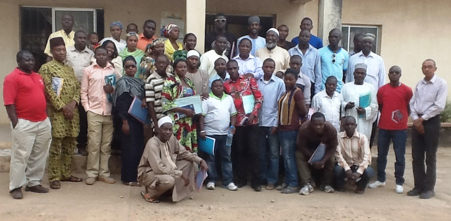 Trained Community Peace Observers of Jos North LGA Plateau State in a group photograph with the Pastor and Imam and other facilitators