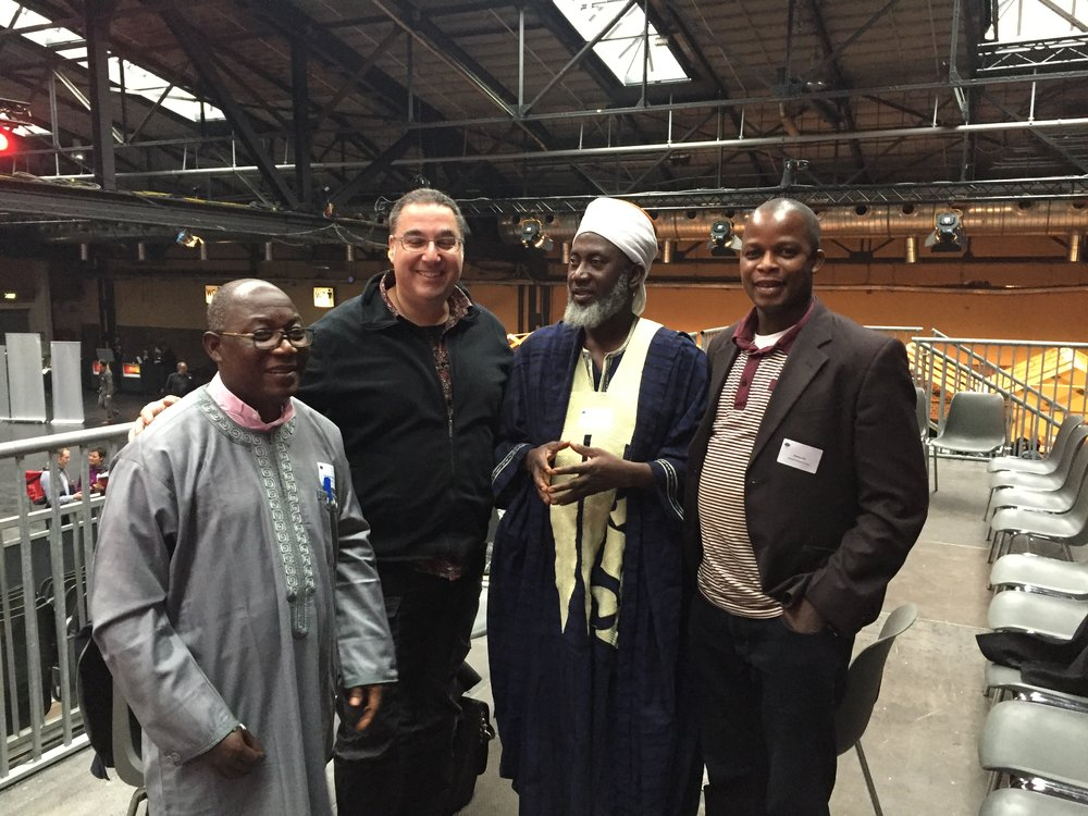 The Pastor and the Imam, Samson of CPAN Department IMC, and a participant at the Innovation Conference on Integration, Berlin Germany