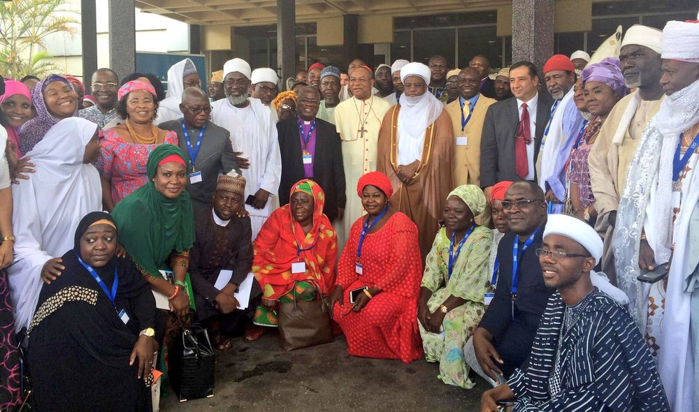 Cross section of some participants in a group photograph during the conference