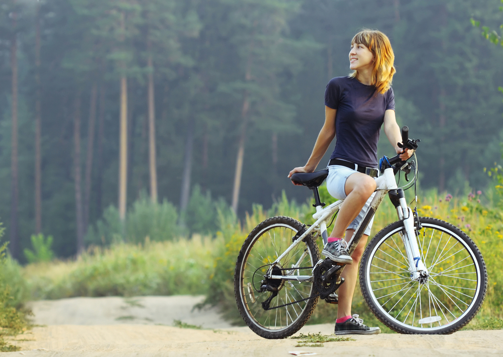 Woman riding bicycle mountain bike forest.jpg