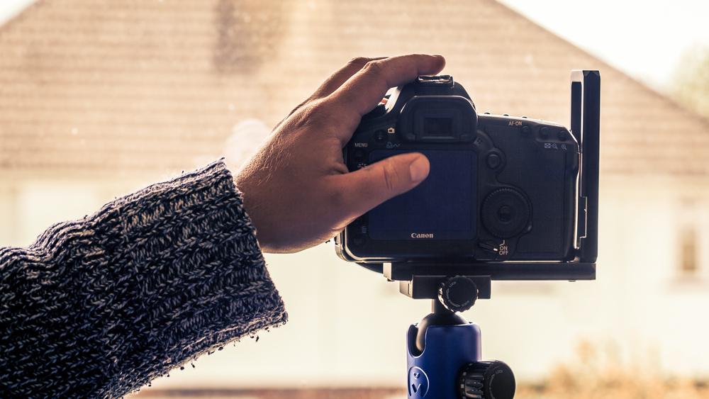 hand on camera