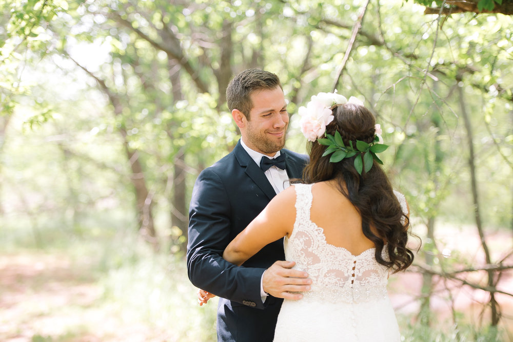 "Following a little ""hidden"" path which opened up into a  ""breathtakingly beautiful, wooded area"" Lucy and Dillon took their romantic first look pictures!"