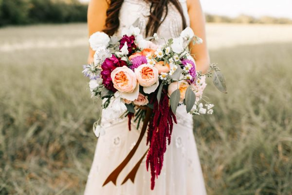 Alongside a gorgeous floral crown, the deep red, yellow, and purple flowers of Alexa's bouquet gave a perfect romantic, fall feeling!