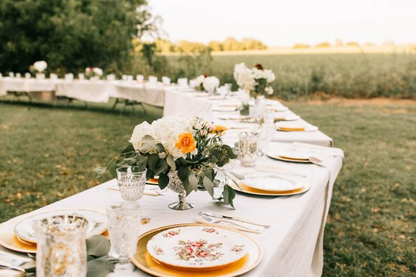 While using our gold chargers, the couple borrowed mismatched china from both sides of the family to put together a gorgeous table setting that symbolizes the joining of the two families!
