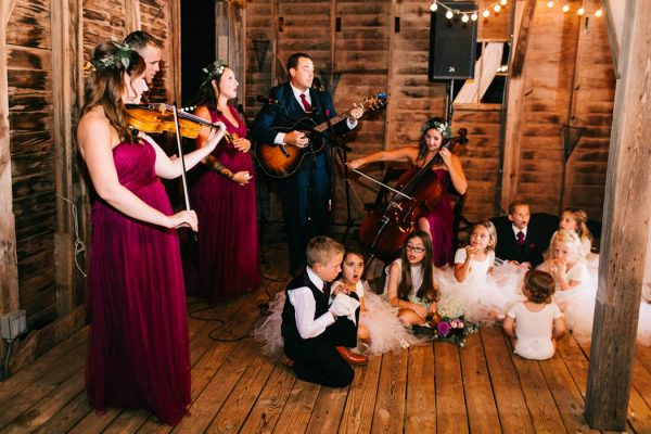 "With their nieces and nephews as back up singers, members of their bride and groom's family performed ""Rivers and Roads"" by The Head and The Heart for their first dance! A beautiful surprise!"