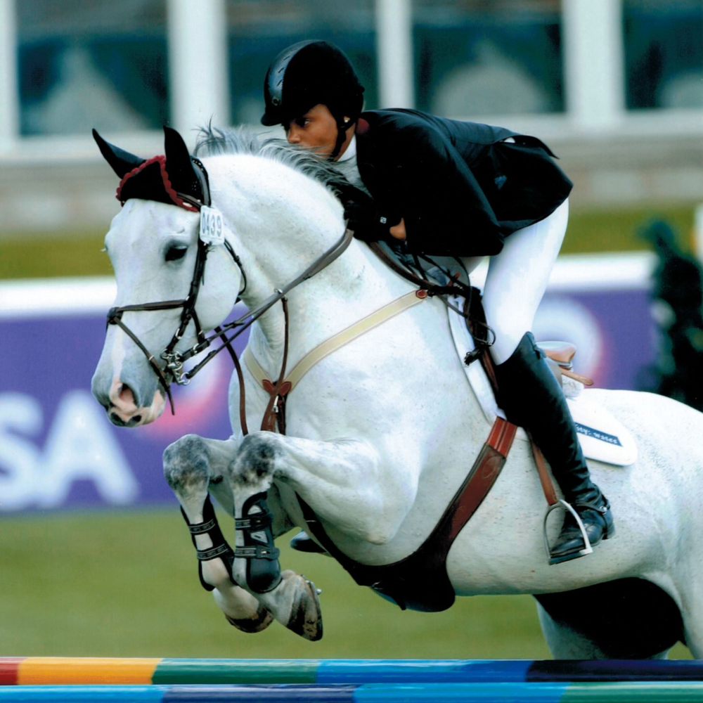 Lauren Kardel and Gerry The Gray Compete at Spruce Meadows