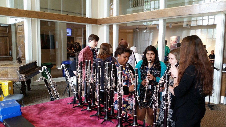 Participating students trying out clarinets