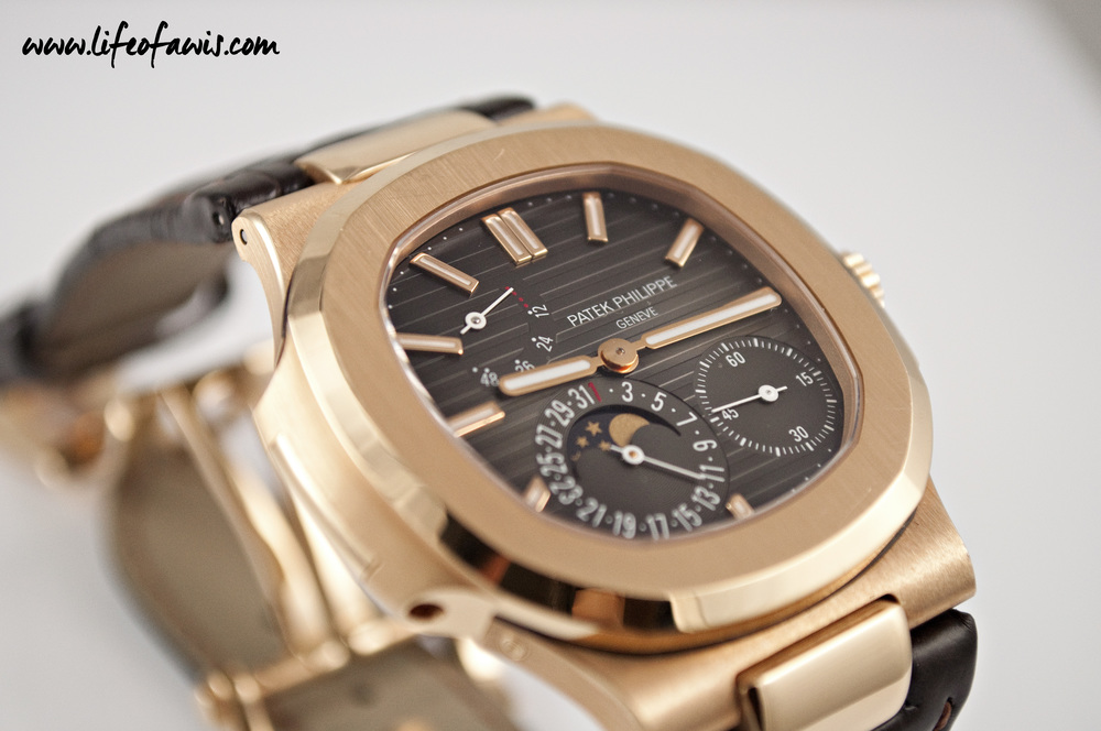 Patek Philippe (ref. 5712R) with the more traditional semi circular power reserve indicator.