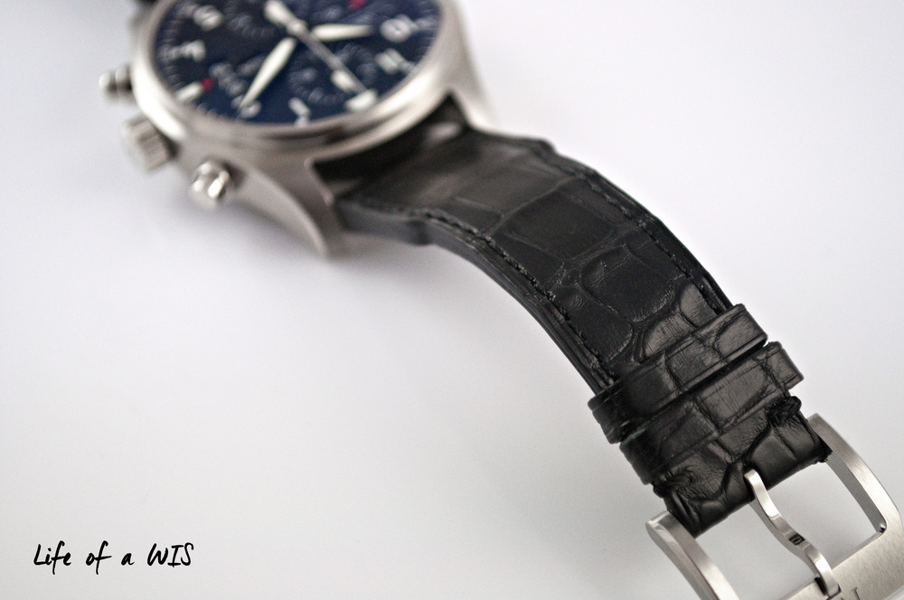The black alligator strap goes well with the Pilot watch, but a riveted version would have been even hotter.
