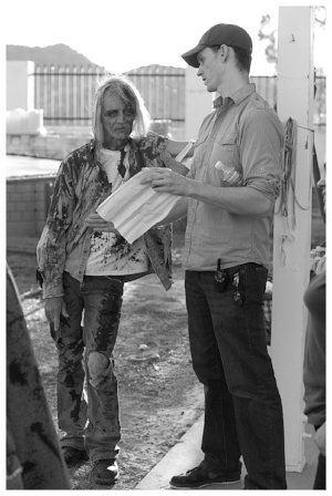 Co-Director David Whelan and extra on set