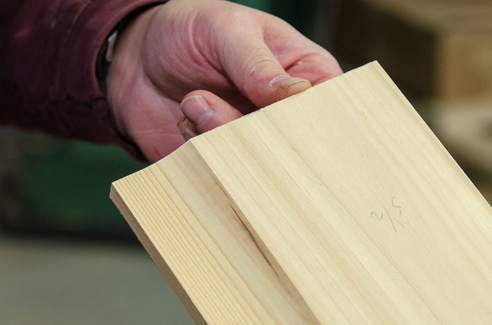Craig uses a router to add a profile to the baseboard similar to the one on the old door