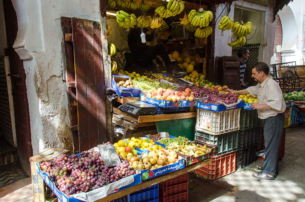 A fruit and vegetable stand in the  souk,  Fès (Fez)