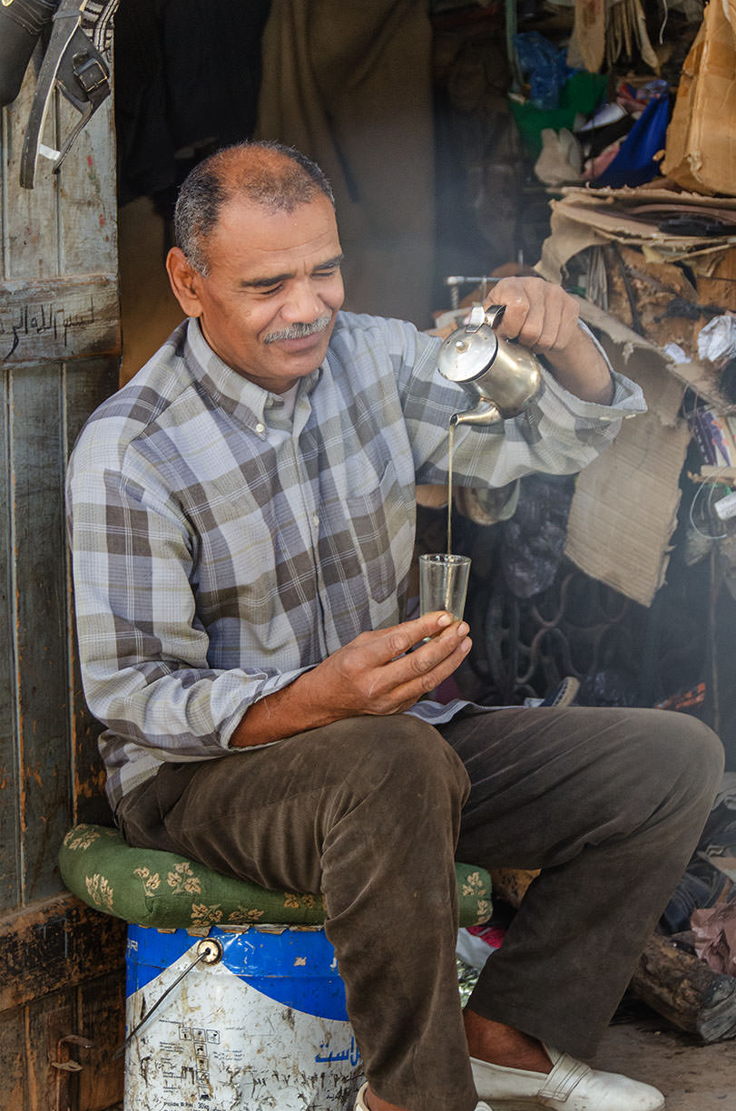 In Morocco, when offered a glass of mint tea, one always accepts. Moroccans (this man is a shoemaker) seem to like pouring it high into the glass as he is doing. I tried to pour the tea and made a big mess.