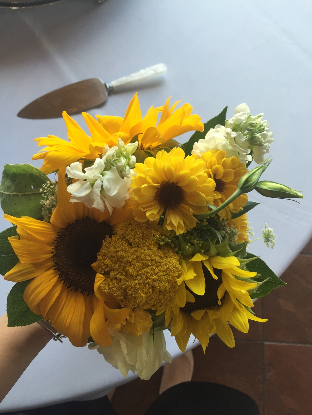 Ah! Katie's bouquet, done by  Morrison's Flowers . You can't deny the perfection of sunflowers!