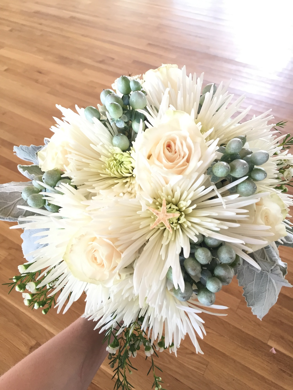 Norfolk Wholesale Florist really hit this one out the park! Starfish acccents! Dusty Miller! Ahh!