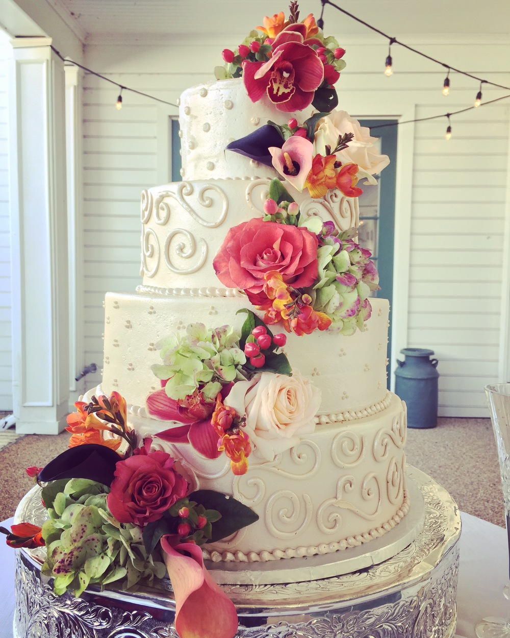It was love at first sight! Cake by Flour Child Bakery, flowers by Kathy Forrest.
