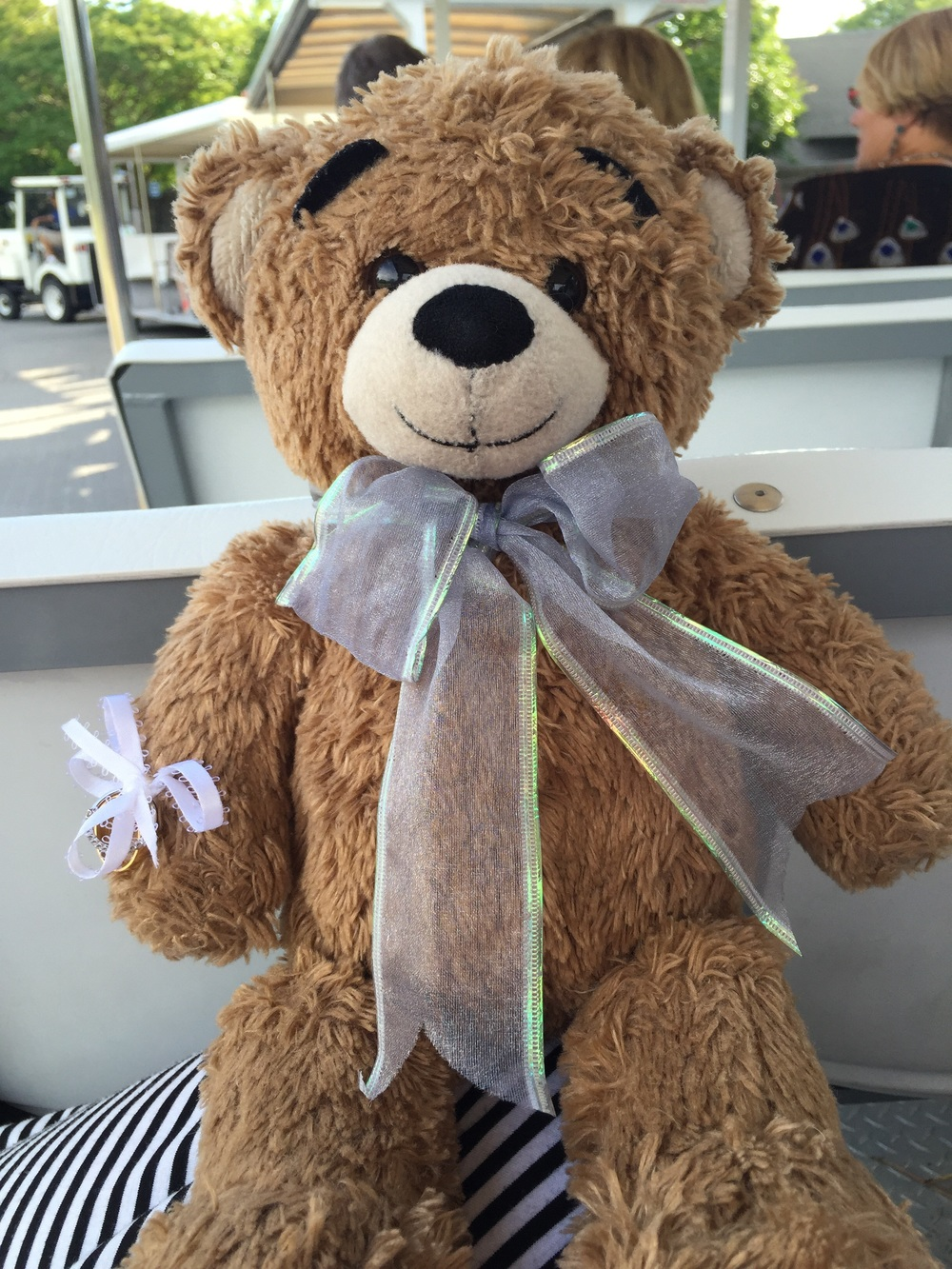 This little guy is one of my favorite details! Matt bought this for Kim when they started dating. Her ring bearer carried this cute teddy down the aisle. SO CUTE!