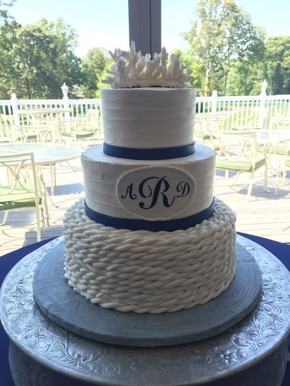 Cindy's Cakery  created this nautical masterpiece. That coral topper was all sugar!! Cake artists amaze me every time!!