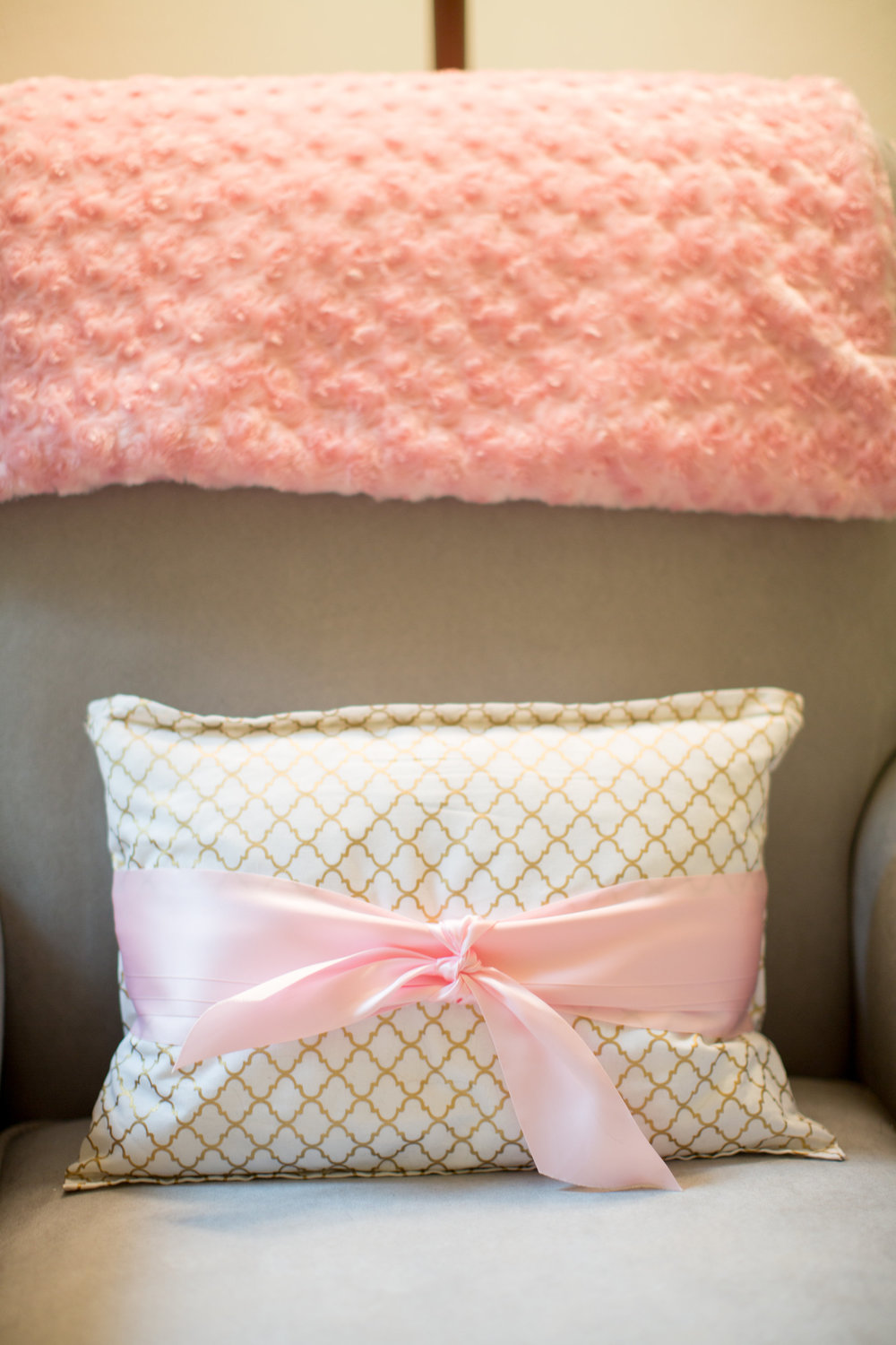 My momma made this beautiful pillow. She got fabric that matched the ribbon valance and finished it off with a sweet little bow. The pink blanket was made for me and baby by my aunt Linda. She made it big enough so we could cuddle up together. I love it.
