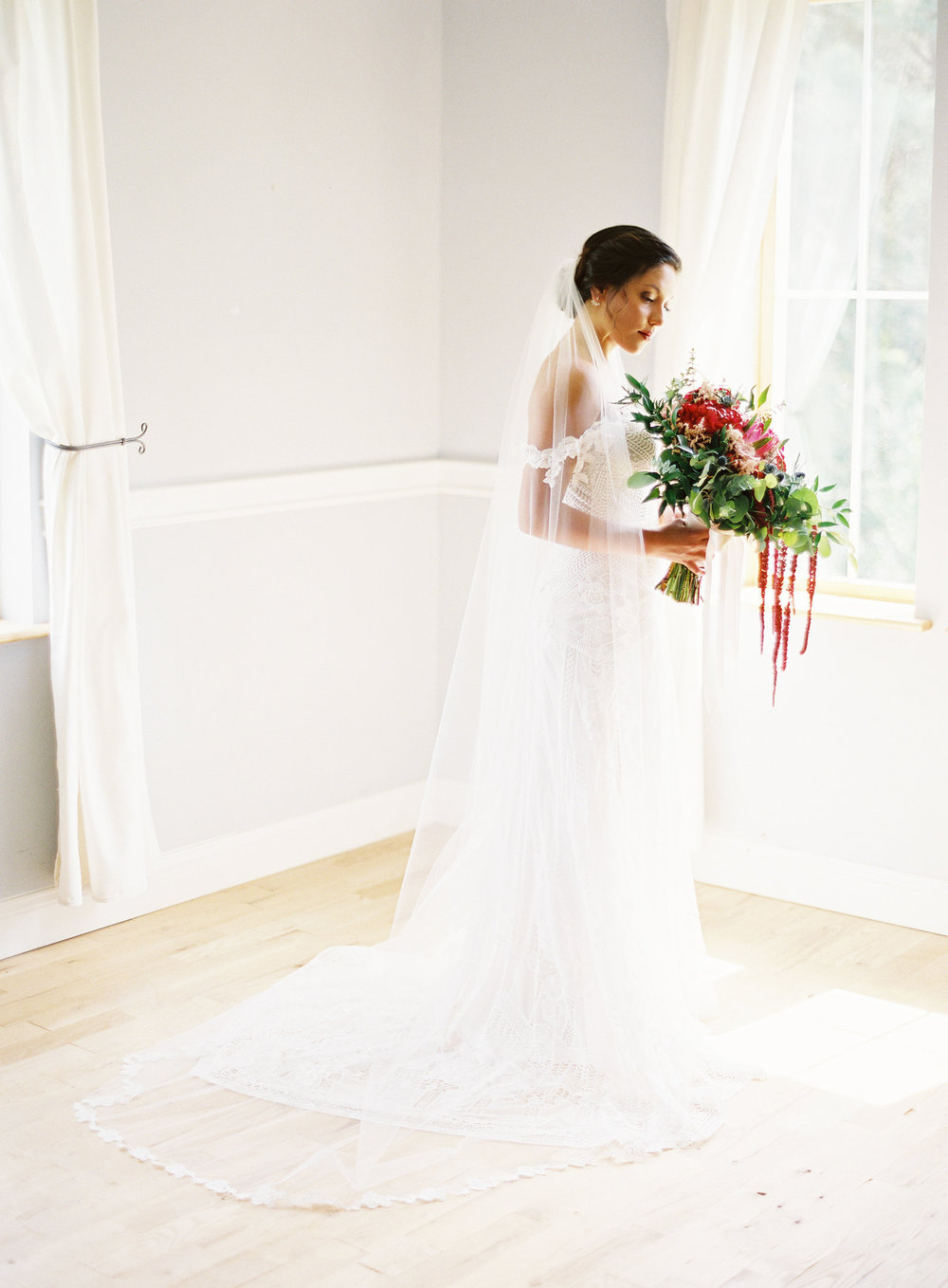 Brides, if your photographer will take the extra time to clear a corner of your getting ready space, you will be thrilled with the outcome. There are no distractions in this shot, even though the room was filled with bags, makeup, lunch, and other items belonging to the bridal party.