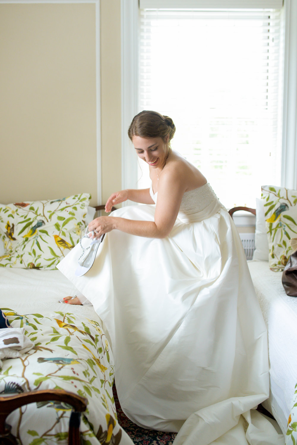 James of  88 Love Stories Photography  got this adorable shot of Katie! I love the pops of color from the comforters! Beautiful and candid.