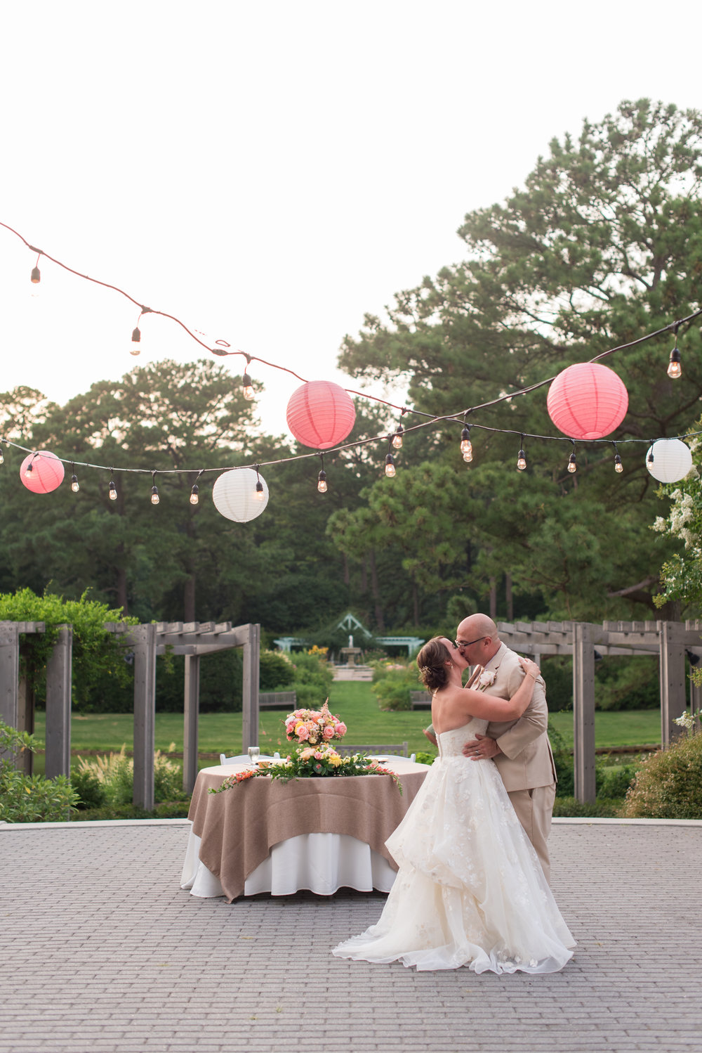 Jamie and Bert shared their first dance under twinkle lights and lanterns. Despite looming rain, Jamie insisted on keeping her reception outside, as planned. Best decision ever! This moment was perfection!  Photo: Caitlin Gerres Photography
