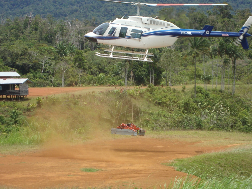 Helicopter with sawmill sling load, Papua New Guinea (PNG)