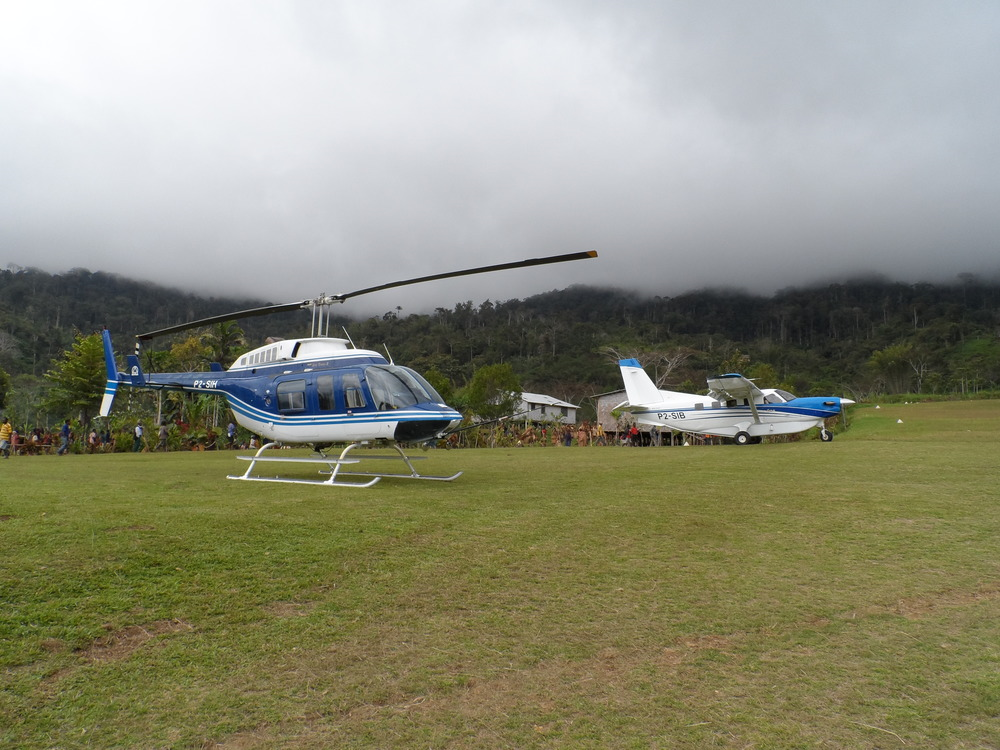 Bell Long Ranger helicopter and Kodiak on community development hire