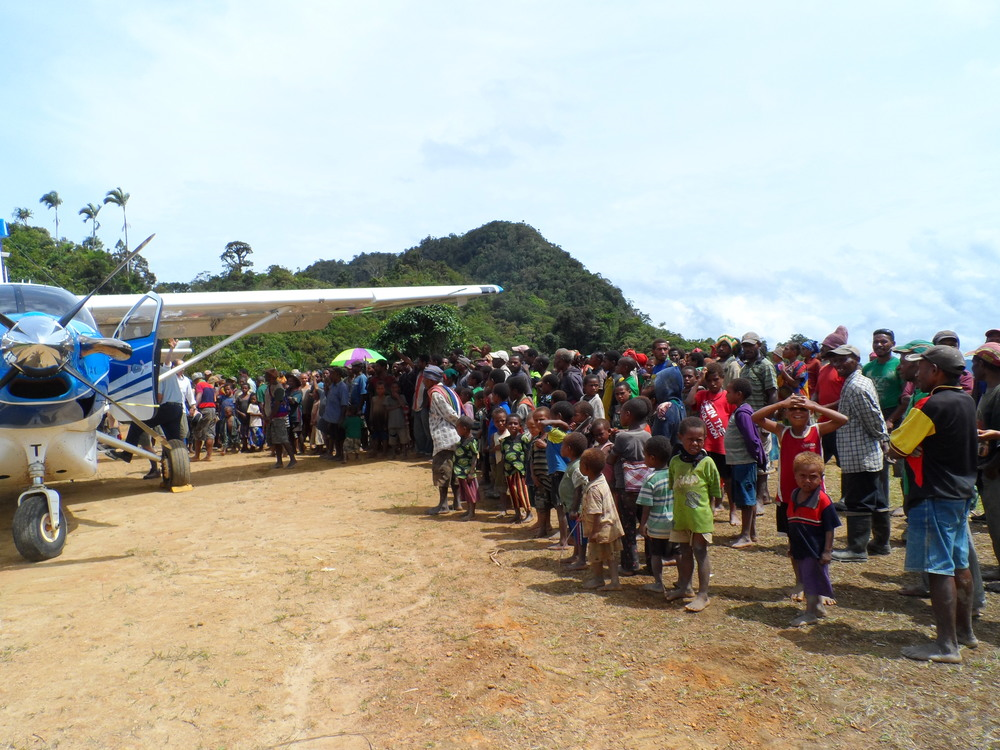 Crowd at an airstrip, Papua New Guinea (PNG)