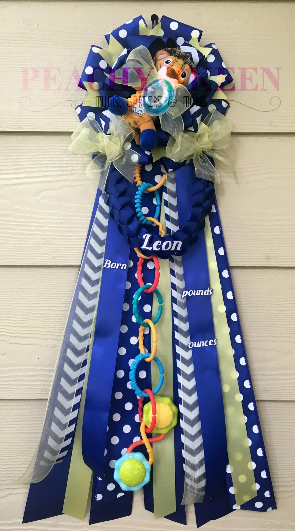 Navy and yellow baby shower mum with lion pacifier