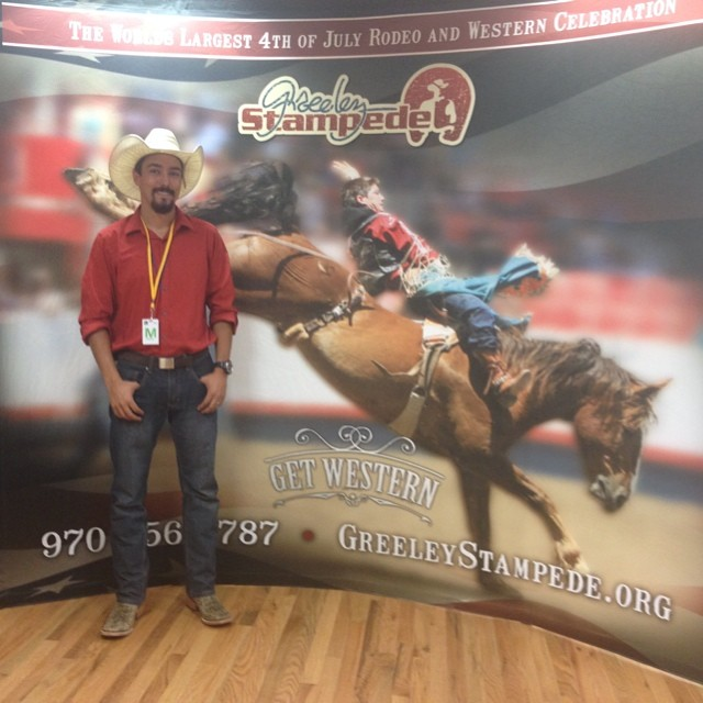 Standing proud next to a photo of mine being used at this year's Greeley Stampede Rodeo!