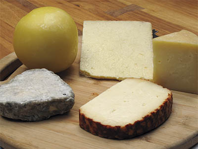 Clockwise from ball: Bola Ocosingo, queso Cotija; Rancho San Josemaría queso de oveja; chili-coated queso del Morral; Pasión