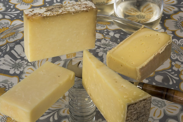 Always Raw: (clockwise from top) 5 Spoke Tumbleweed; Meadow Creek Grayson; Matos  St. George; Grafton Village 2-Year Cheddar