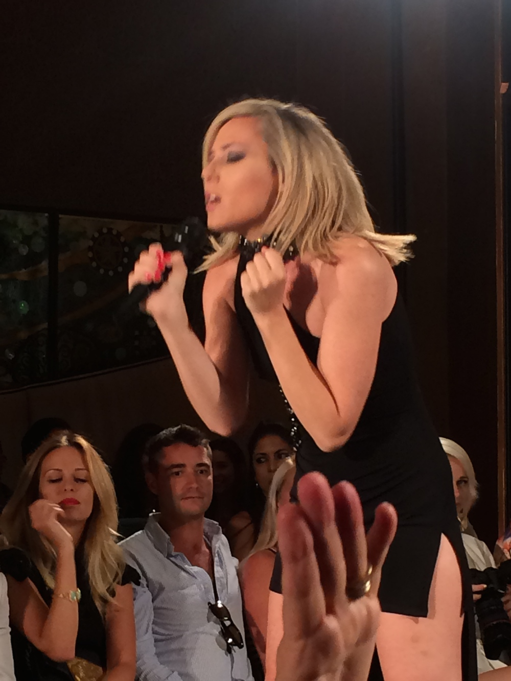 Singer, Beca Dreams performing at the Julian Chang Fashion Show in Miami Beach, Fla.