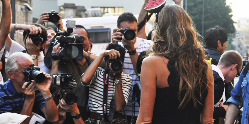 Photographers snapping Anna Dello Russo, the editor-at-large and creative consultant for Vogue Japan.