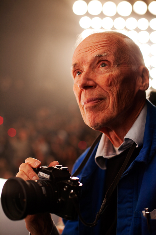 New York Times photographer Bill Cunningham and the subject of the documentary Bill Cunningham New York gearing up to photograph a New York fashion show. Image by Scott Schuman of the Sartorialist.