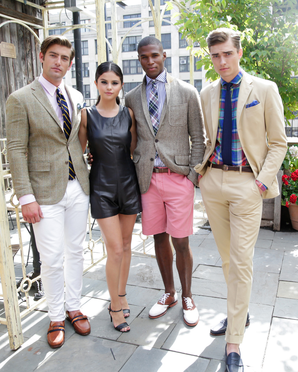 Selena Gomez posing with male models, including Justin Hopwood at the Spring 2016 POLO Ralph Lauren presentation. Image via Ralph Lauren.