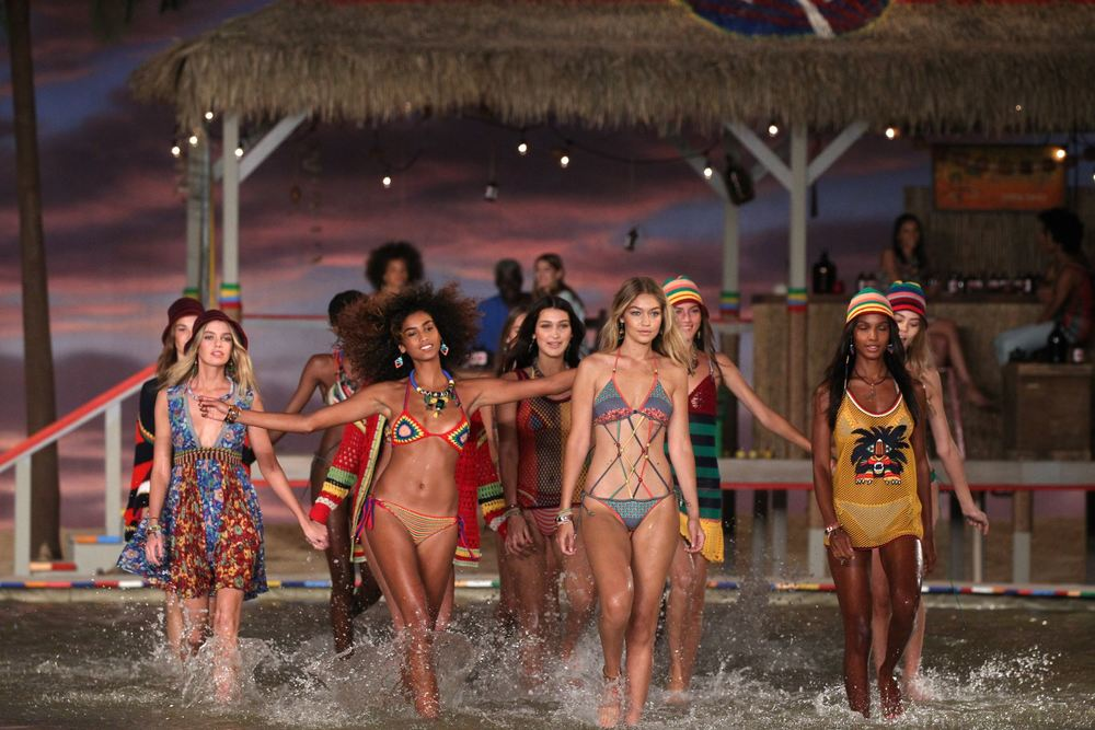 Gigi Hadid and a fleet of models parade down the island themed runway at the Tommy Hilfiger Spring 2016 collection.