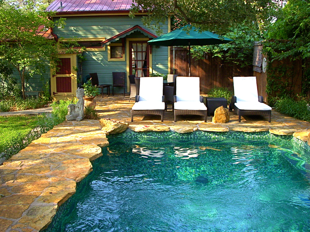 Relax at our eco-oasis in the heart of Austin's SoCo district in ourprivate cottages, with swimming pool, outdoor shower, organic gardens, and onsite massage therapy.