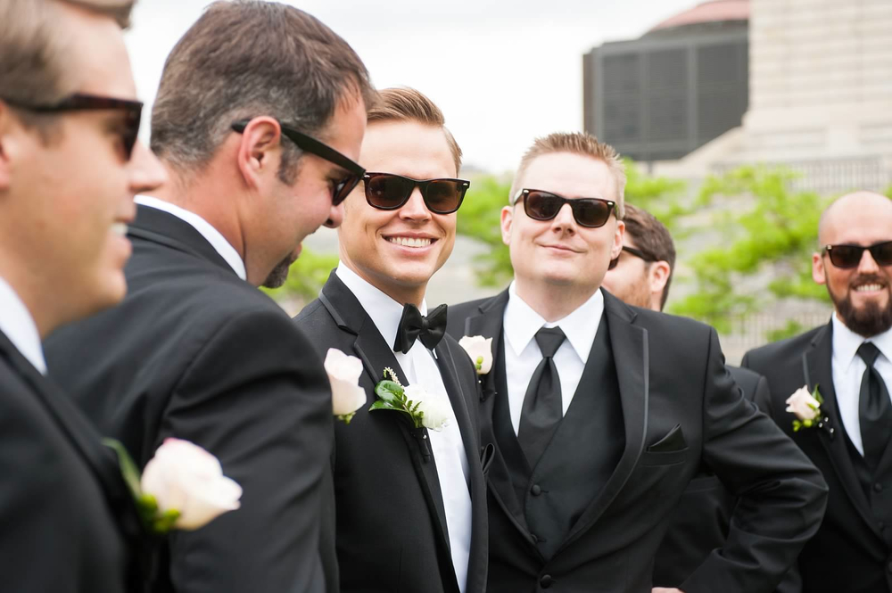 Groom+and+groomsmen+with+white+boutonnieres+and+black+Ray Ban+sunglasses - Mn Wedding