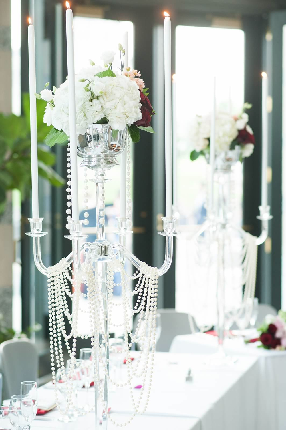 Head table pearl draped crystal candelabra centerpieces with white flowers.jpg