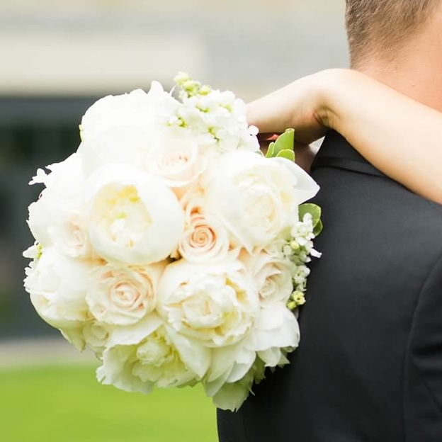 Bride and groom with white peony and rose bridal bouquet.jpg