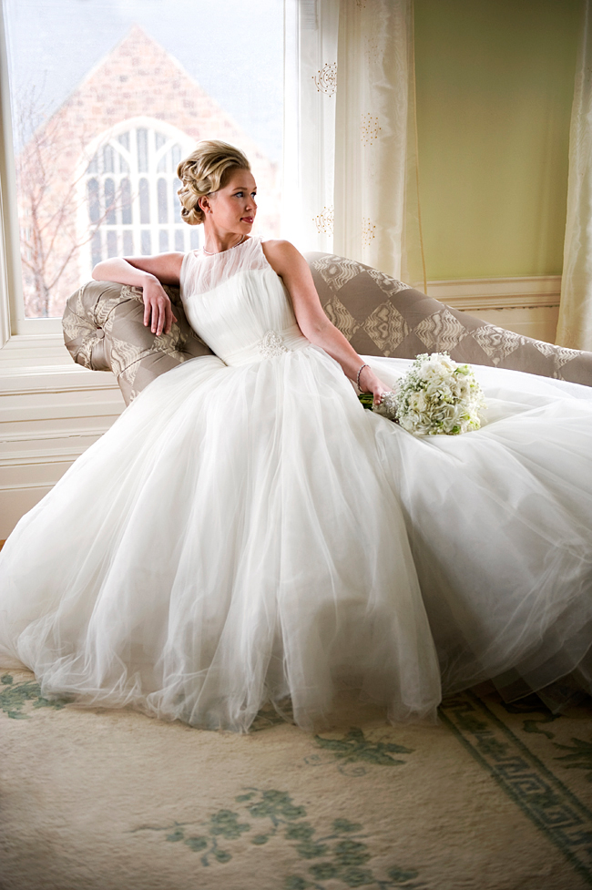 Grace Kelly bridal style with bouquet on chaise