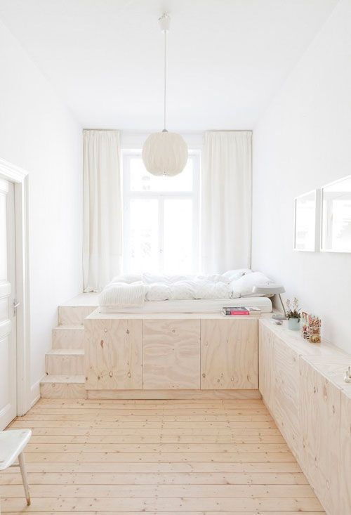 A great way to get more space specially in the bedroom is to build up, because here you will usually not need at lot of hight in the bed area. In this way you will create a lot of extra storage.