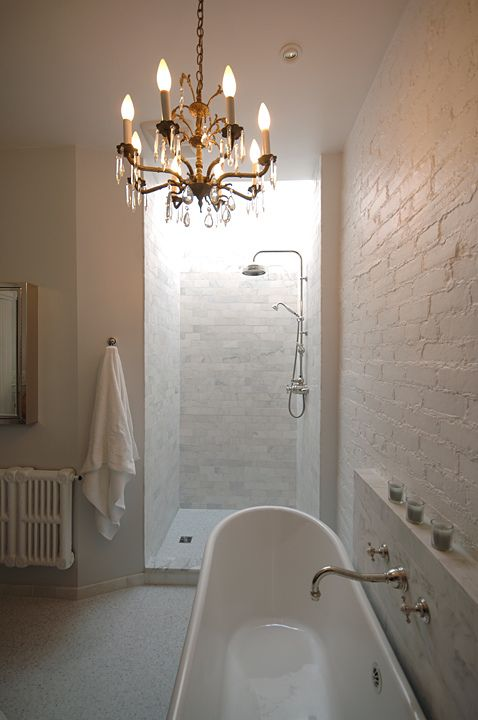 Refine your bathroom with a chandelier and get that hotel mood.