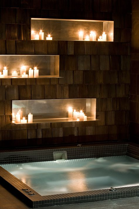 Use candles to get the cozy and romantic feeling even in a very minimalistic styled bathroom.