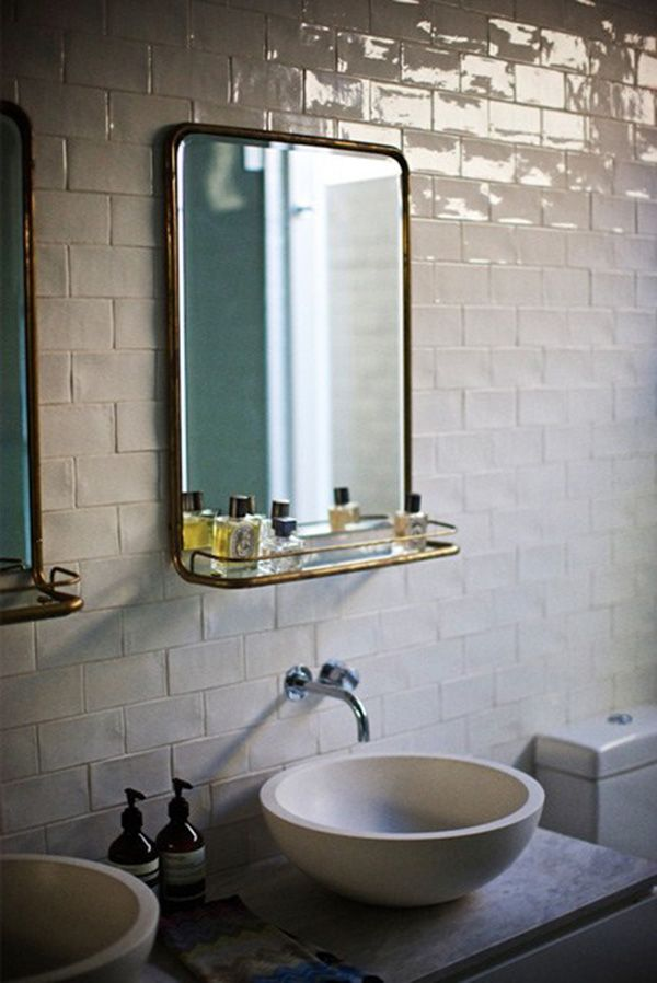 Beautiful glazed tiles in white gives the feel of a room warmth in the bathroom.